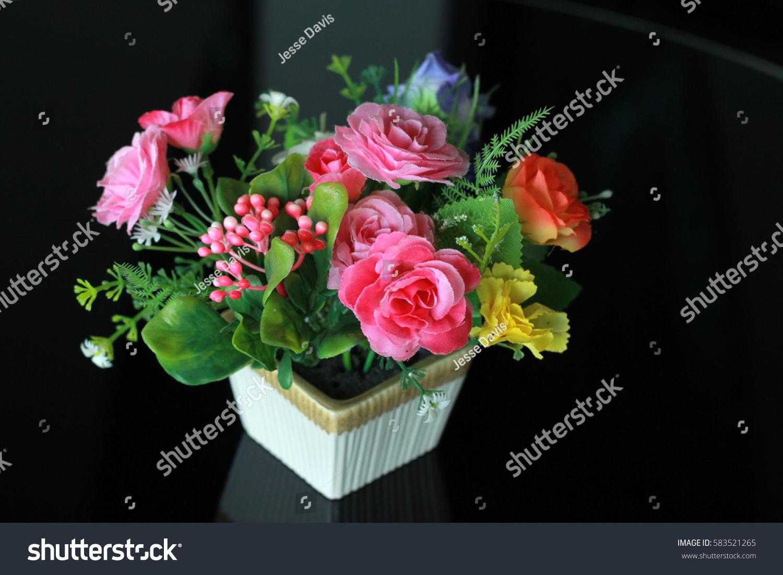 Small pretty pink flower arrangement on stock photo edit now small but pretty pink flower arrangement on a black table mightylinksfo