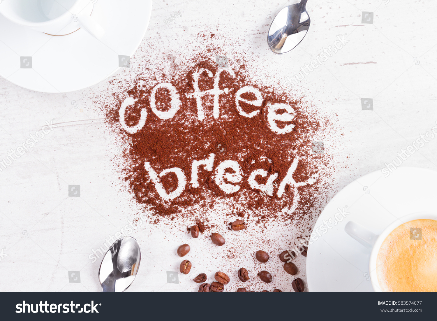 coffee break concept - cups of espresso, spoons and coffee break lettering #583574077