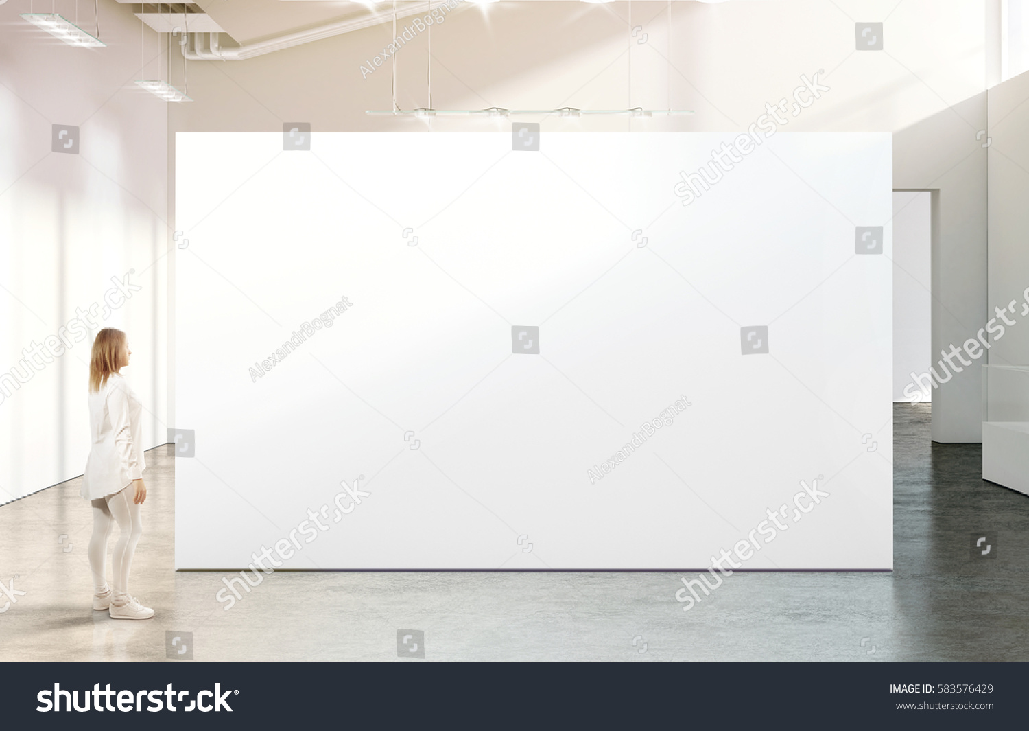 Modern Exhibition Stand Near Me : Woman walking near blank white wall stock photo