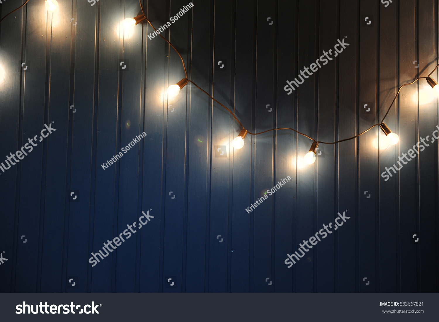 Blue wall with retro garland of light bulbs. Texture for the design or text & Blue Wall Retro Garland Light Bulbs Stock Photo 583667821 ... azcodes.com