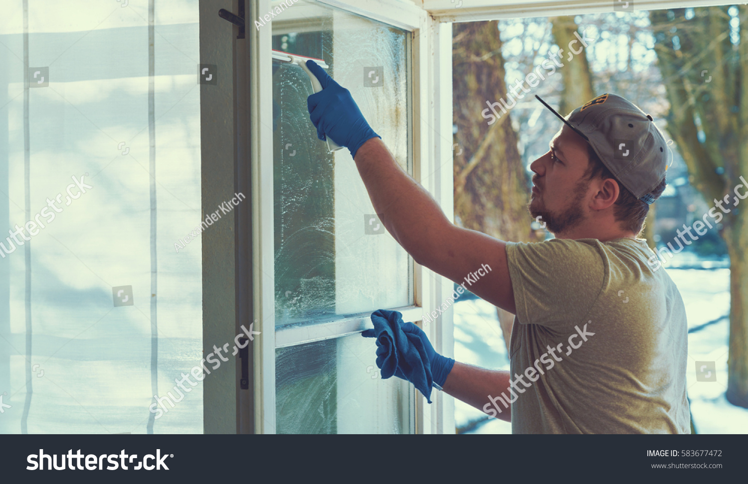 Young Man Using Rag Squeegee While Stock Photo 583677472