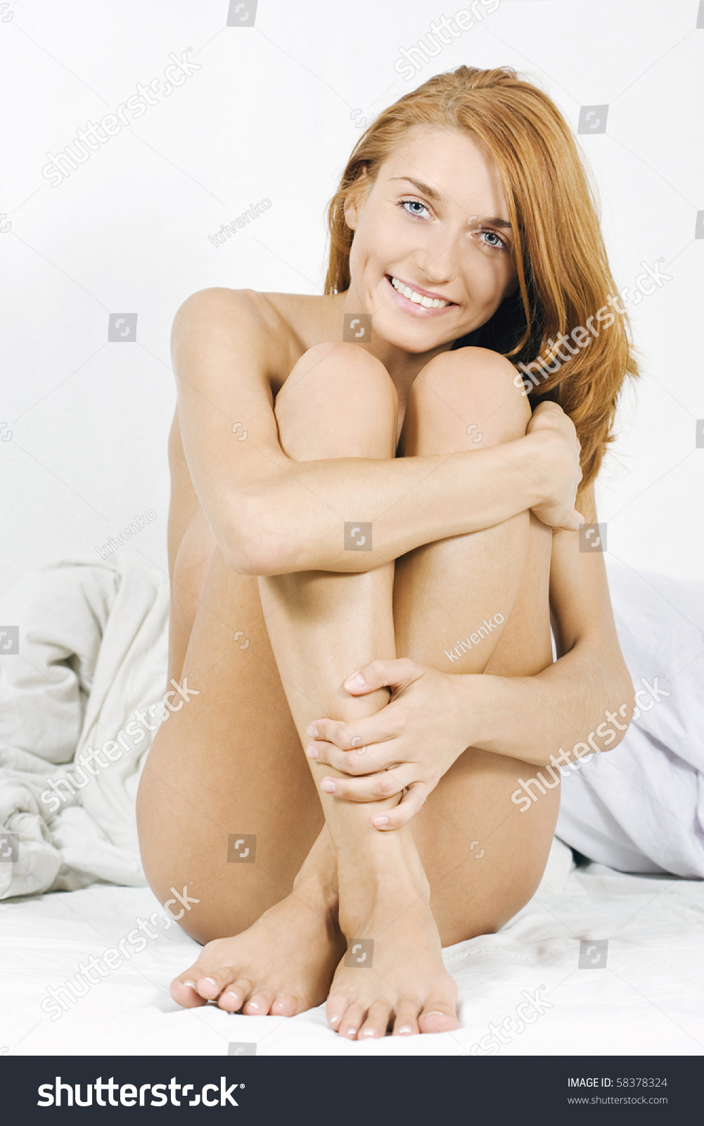 Happy Sexy Naked Girl Sitting On Bed