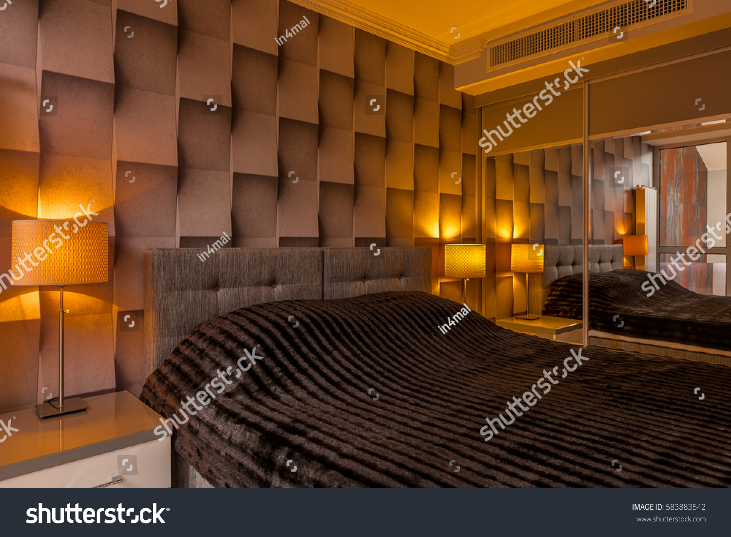 stock photo modern designed bedroom with creative brown d wallpaper and big bed 583883542