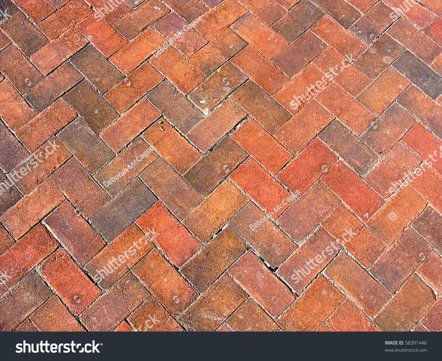 Red Paving Stones : Red brick paving stones on a sidewalk stock photo