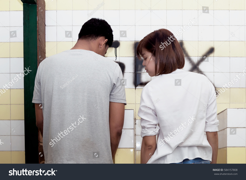 Guy urinating alone