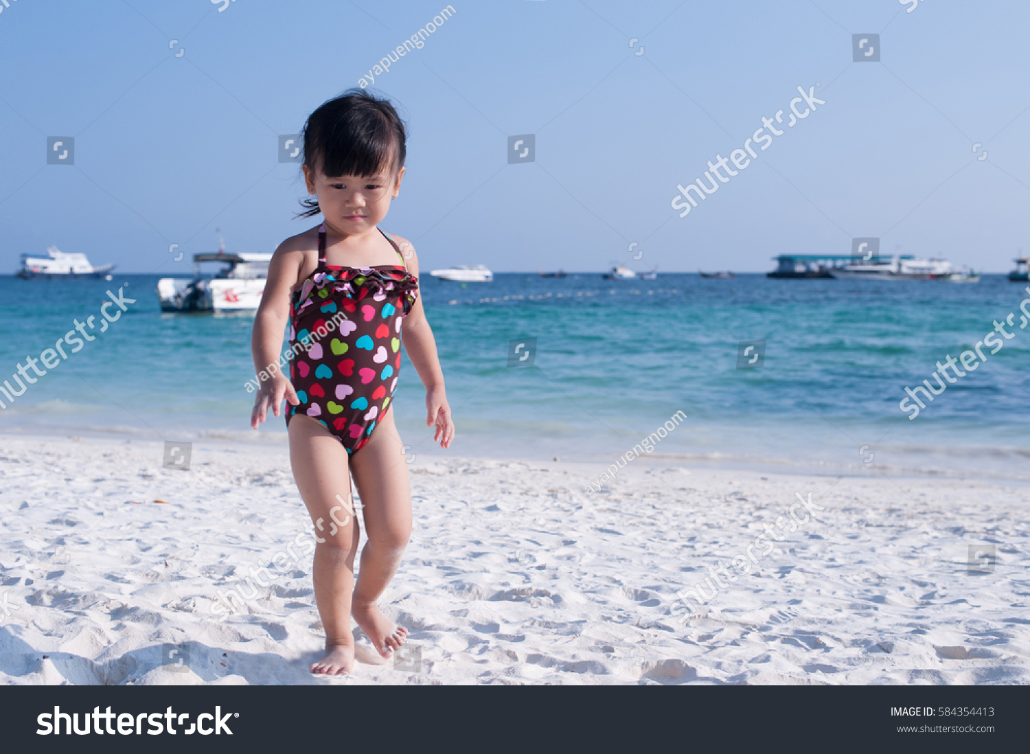 Young asian teens at the beach apologise