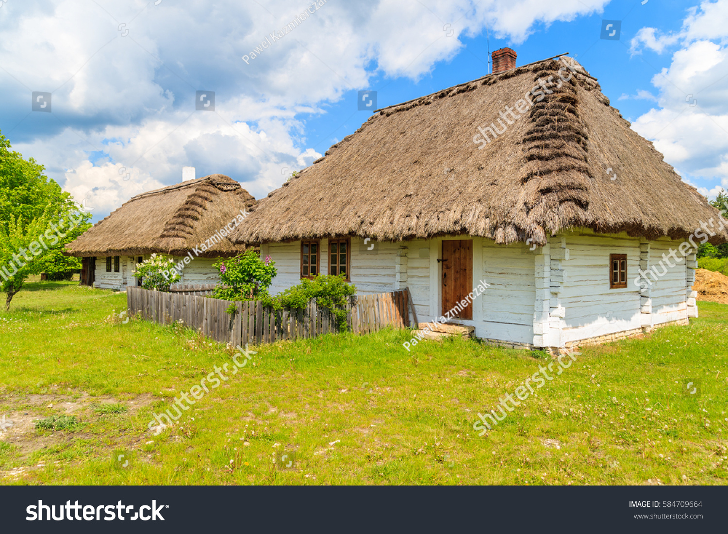 Old traditional houses straw roof tokarnia stock photo for Old traditional houses