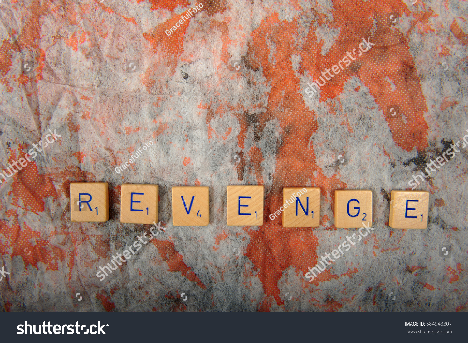 Board Game Letters Spelling The Word Revenge On Grey And Brown Speckled Cloth Sfrom