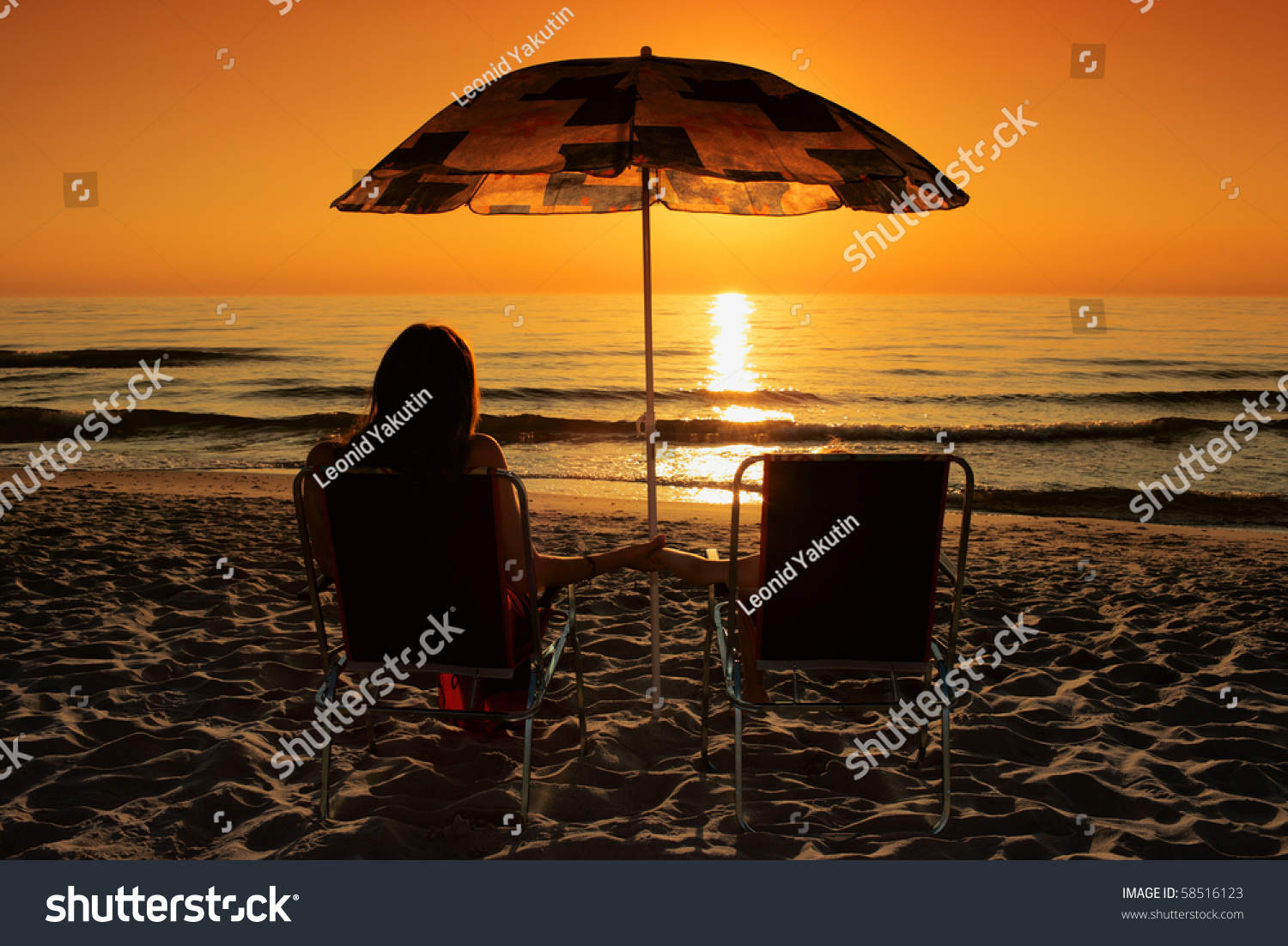 Beach sunset with chairs - Save To A Lightbox