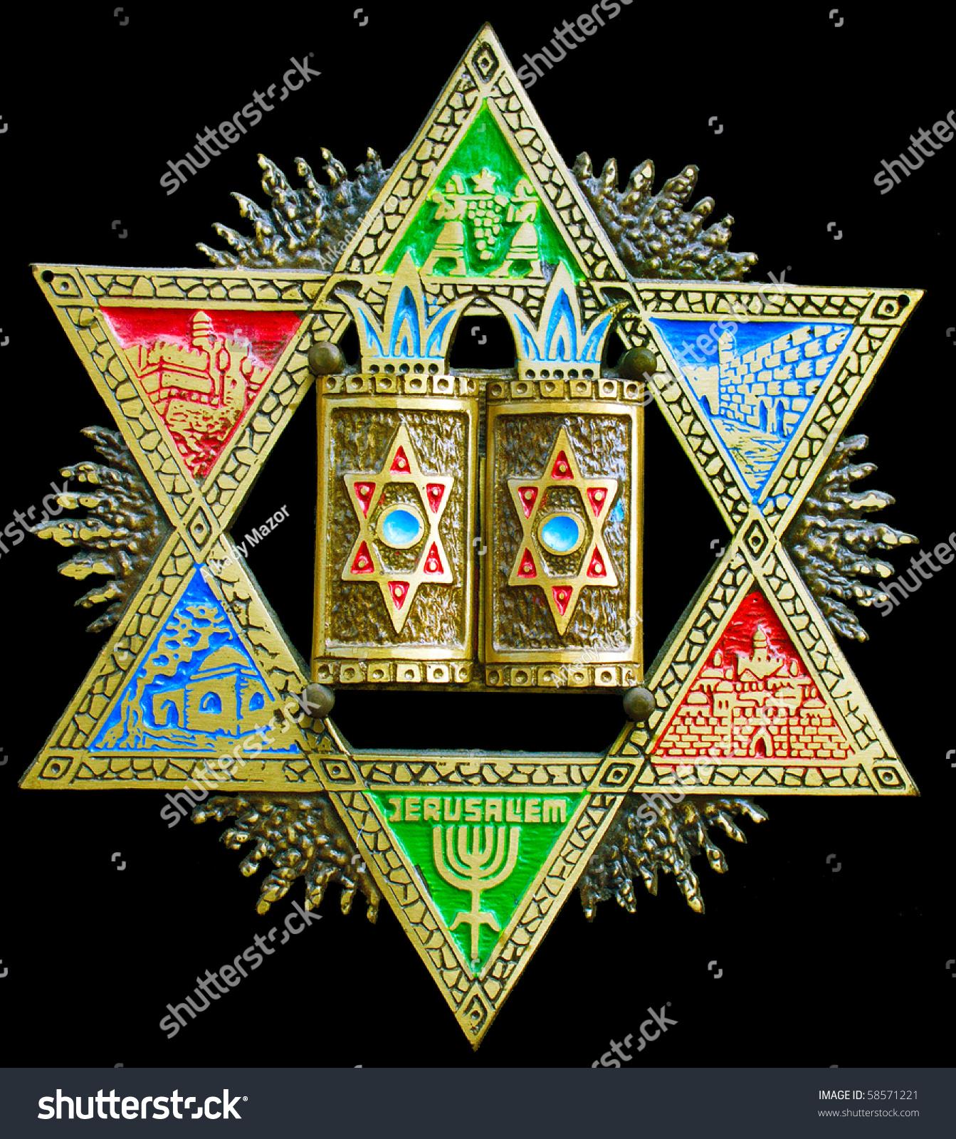 The Dodge Star And Jewish History: Antique Handmade Bronze Magen David Engraved Stock Photo