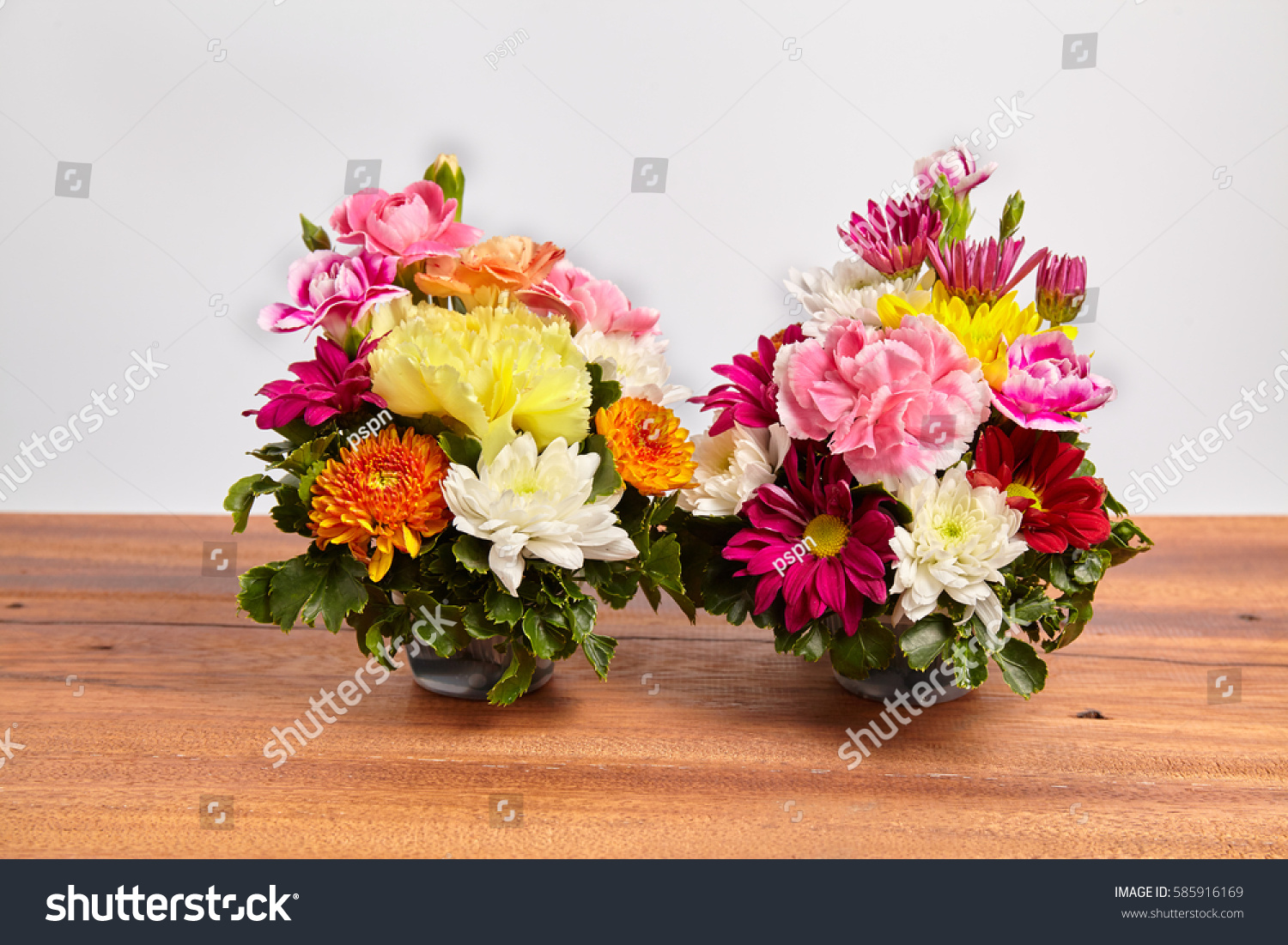 Beautiful bouquet of fresh flowers on wooden table ez canvas id 585916169 izmirmasajfo