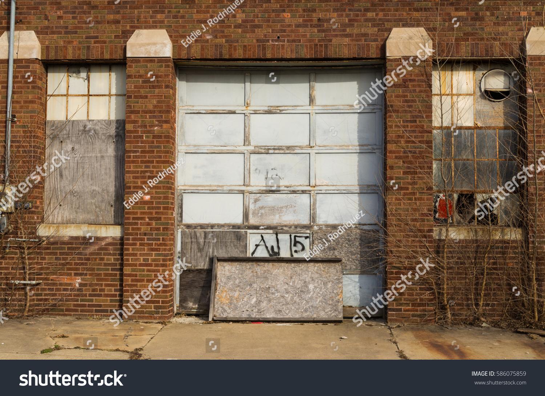 Old garage door and broken windows in small midwest town