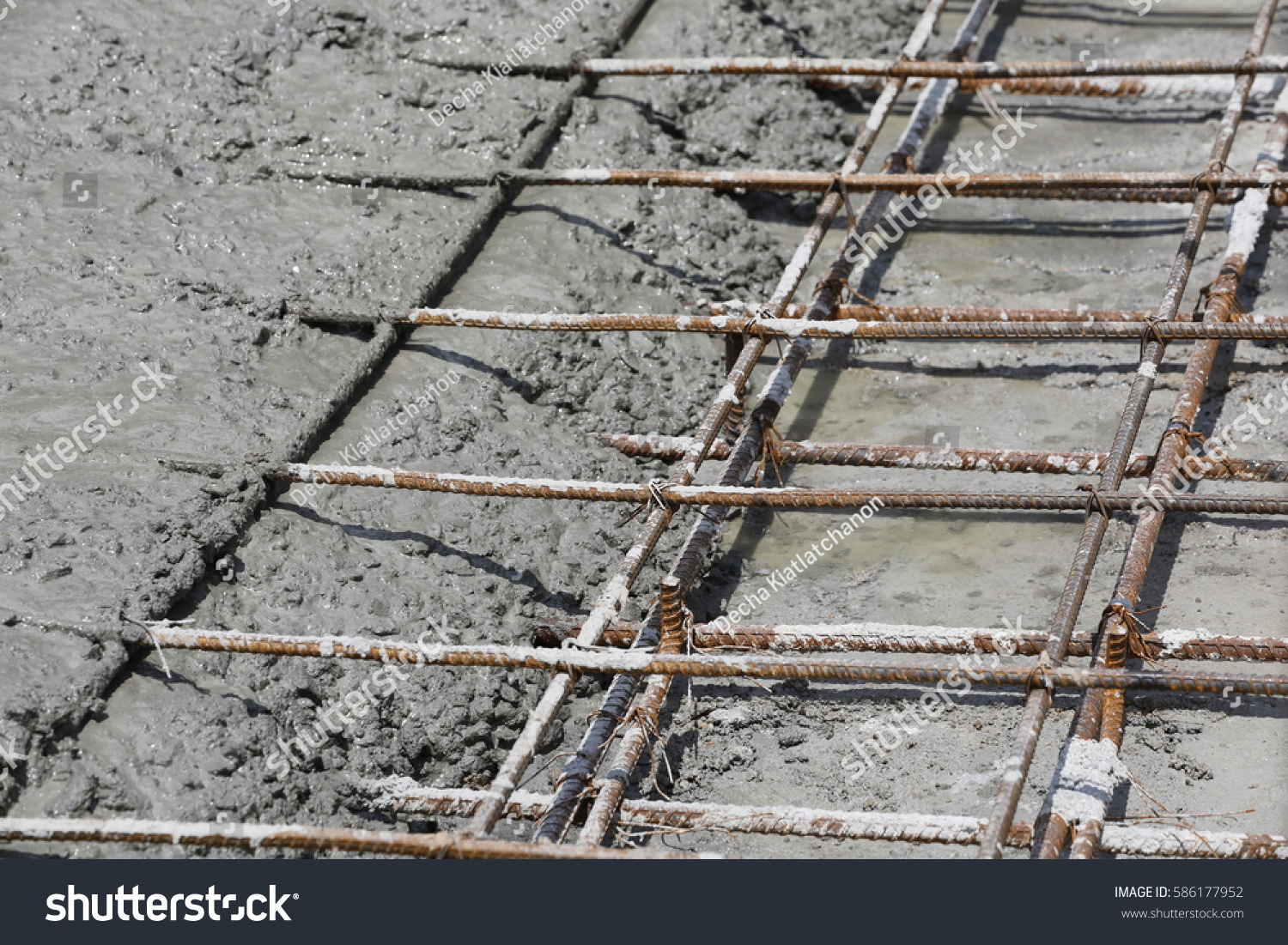 Wet Concrete Poured On Wire Mesh Stock Photo (Safe to Use) 586177952 ...