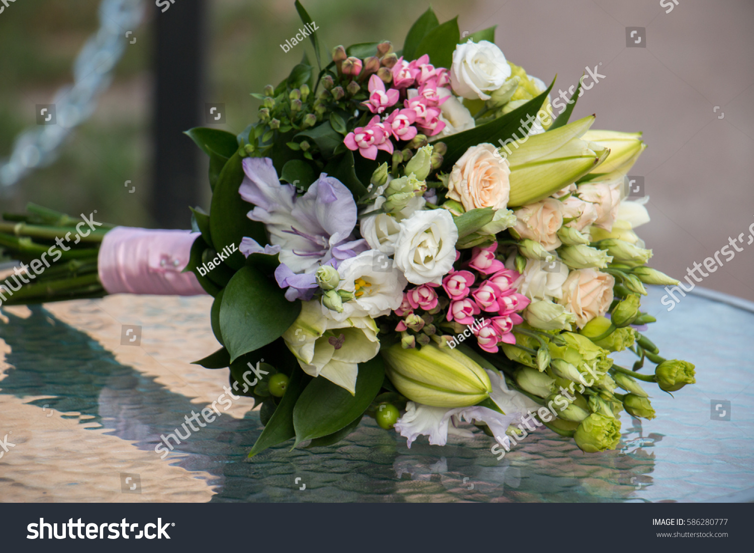Wedding bouquet of lily flowers on glass table ez canvas id 586280777 izmirmasajfo