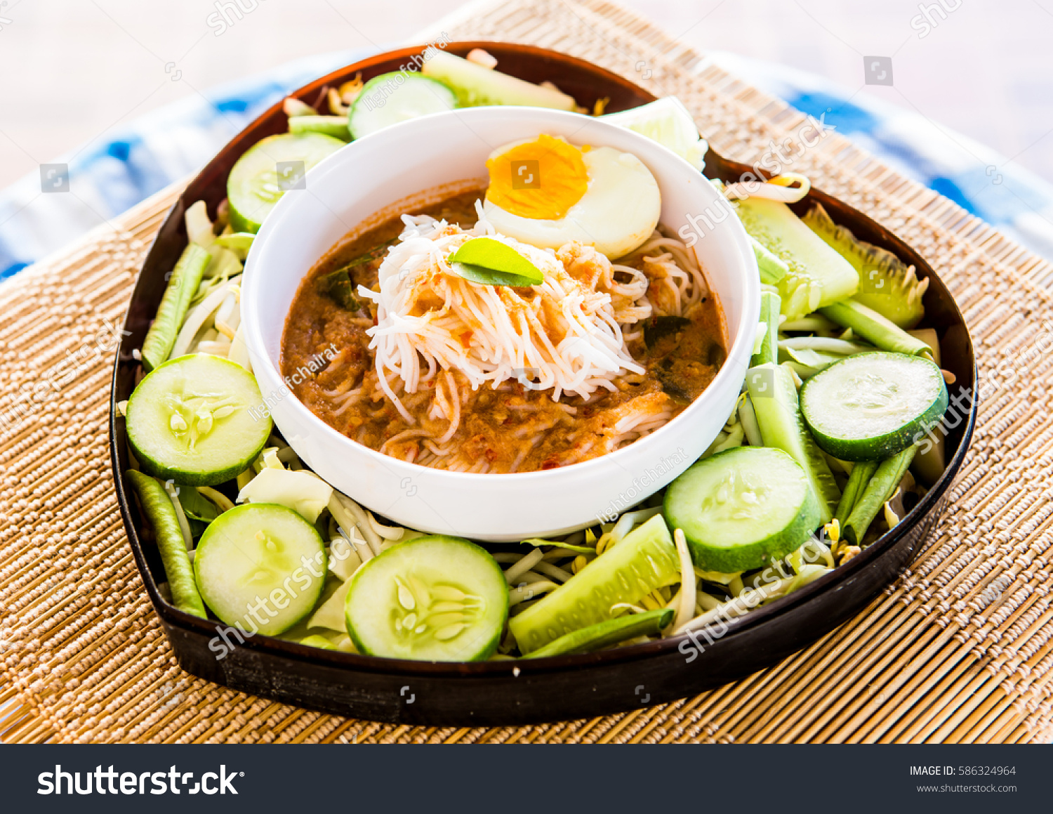 noodles with fish curry sauce or Kanom Jeen Nam Ya , Thai food #586324964