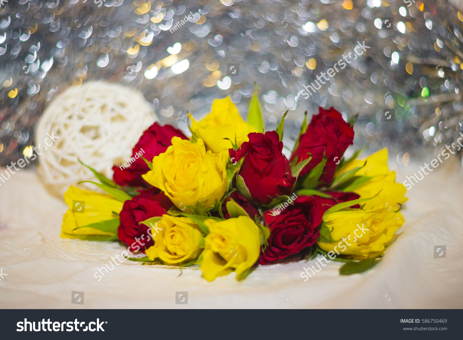Red yellow small roses buds bokeh stock photo download now red and yellow small roses buds with bokeh and ball of twigs on the background shallow mightylinksfo