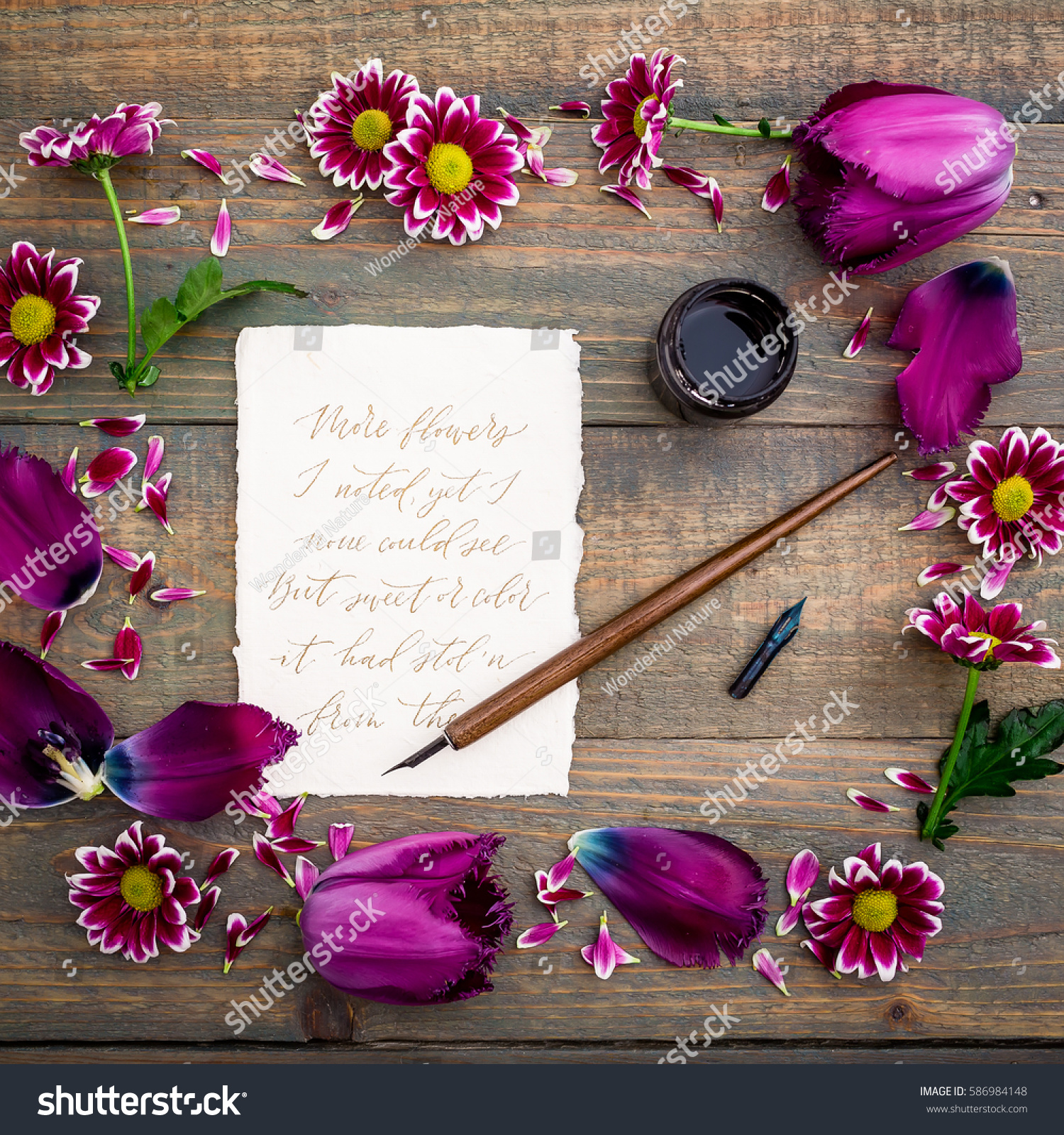 Calligraphic Text Written On Paper Card And Flowers On Rustic