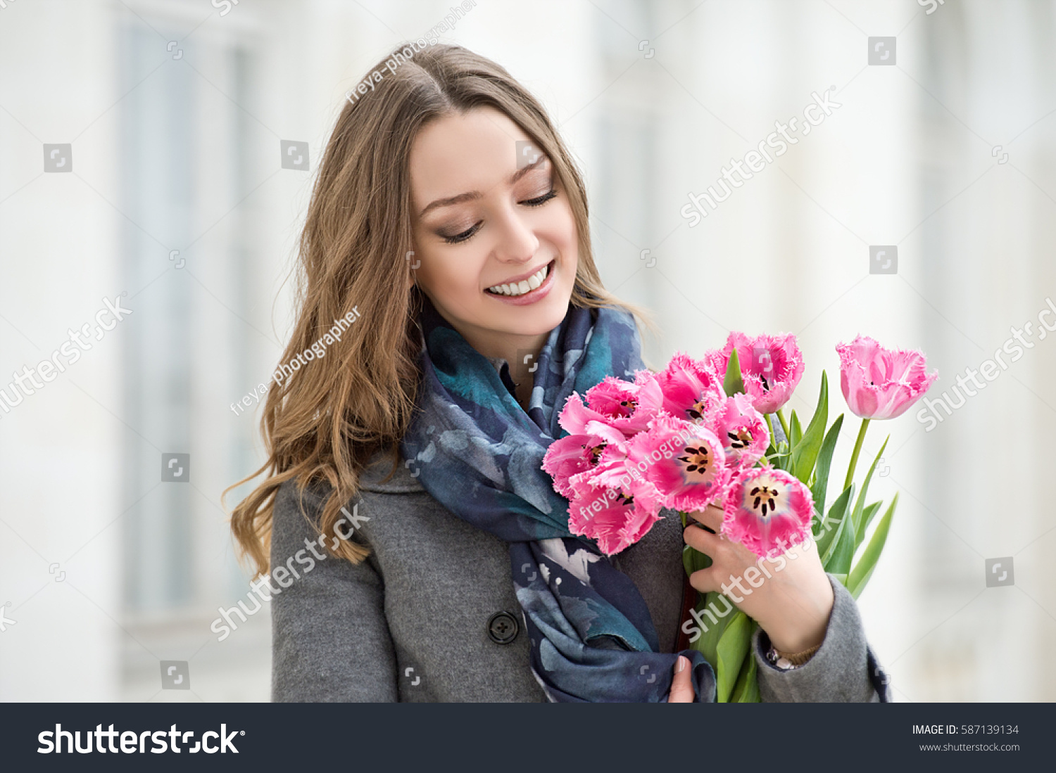 Woman tulips beautiful woman flowers stock photo royalty free woman with tulips beautiful woman with flowers izmirmasajfo Image collections