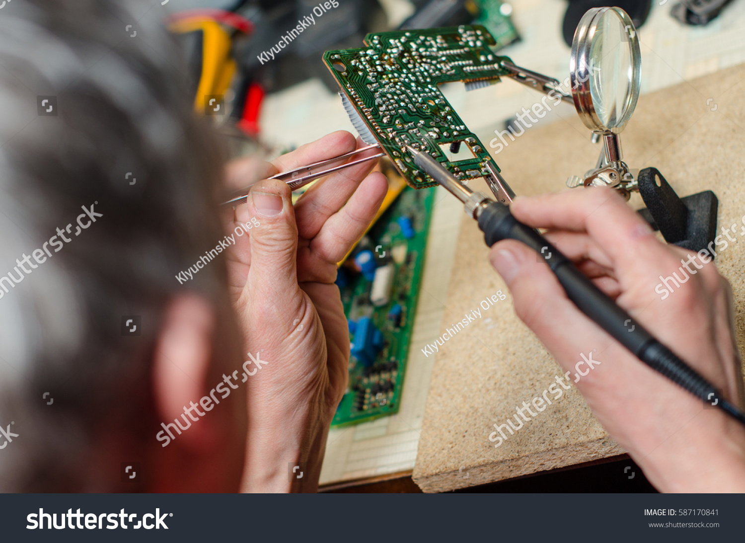 Electronic Technician Repairs Mobile Phone Using Stock Photo Edit Repairing Circuit Board With Soldering Iron Tweezers And Magnefier