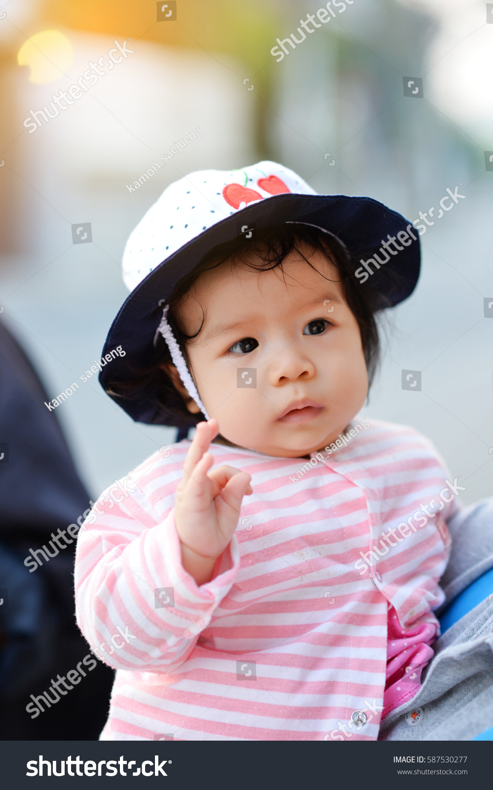 sweet beautiful baby girl red baby stock photo (safe to use