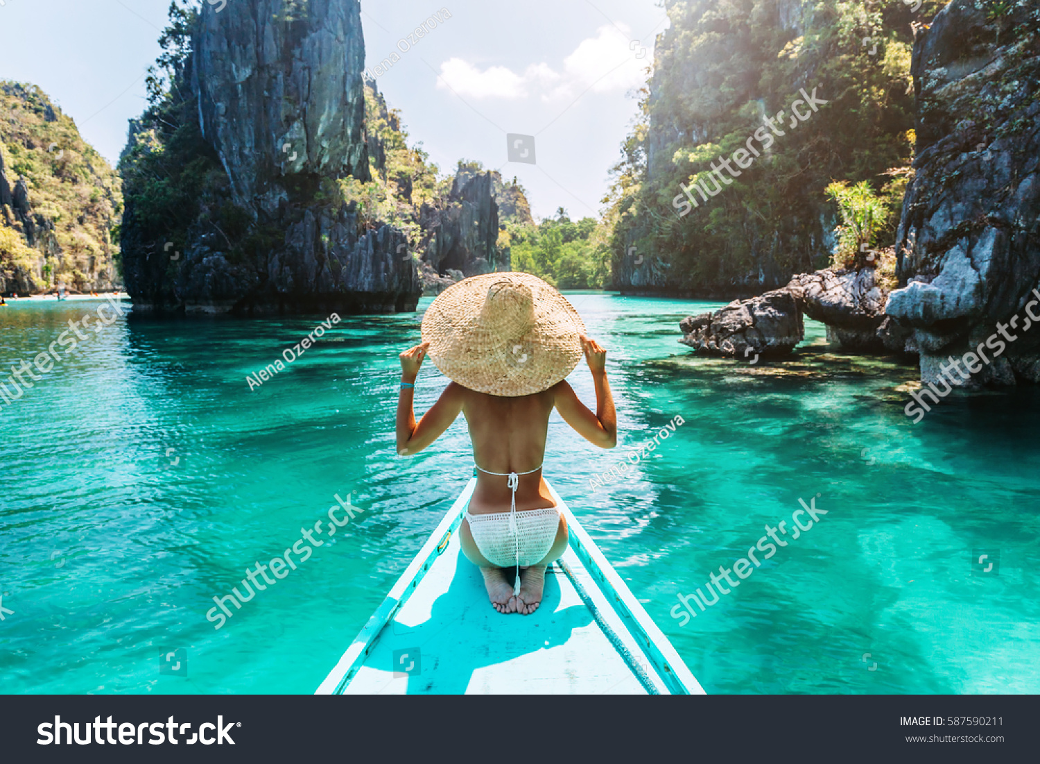 Back view of the young woman in straw hat relaxing on the boat and looking forward into lagoon. Travelling tour in Asia: El Nido, Palawan, Philippines. #587590211 - 123PhotoFree.com
