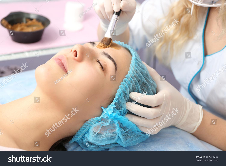 Young woman having beauty treatments salon stock photo for A trial beauty treatment salon
