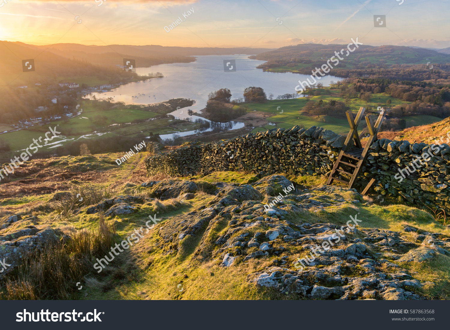 Lake Windermere in the English Lake District taken at sunrise with vibrant colours and golden morning light. #587863568