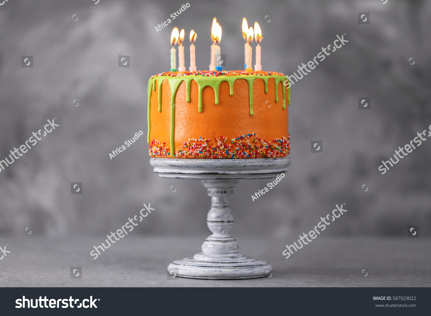delicious cake happy birthday candles on stock photo