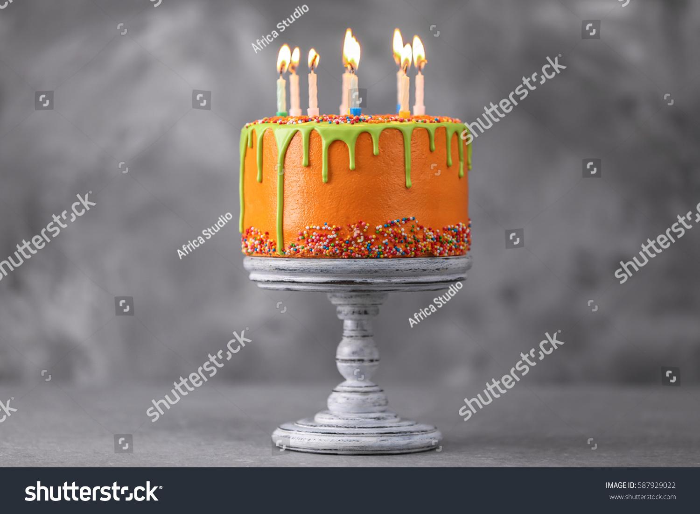 delicious cake happy birthday candles on stock photo