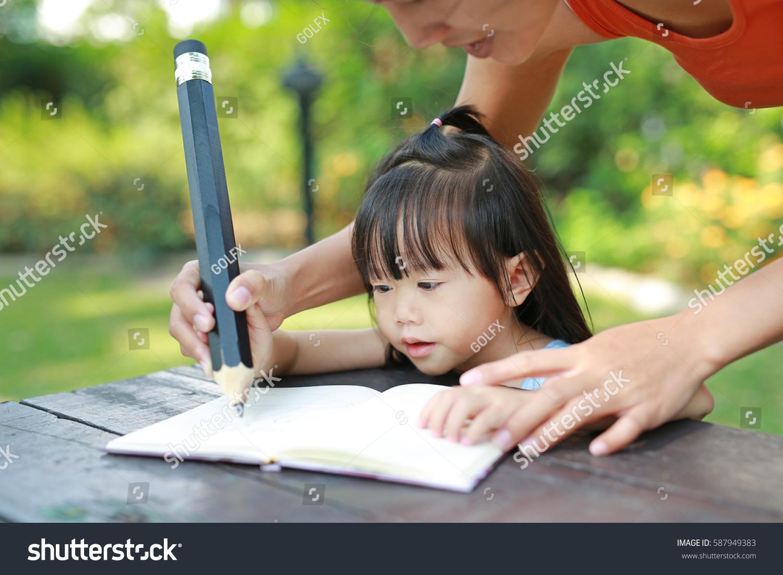 mother teaching daughter 247