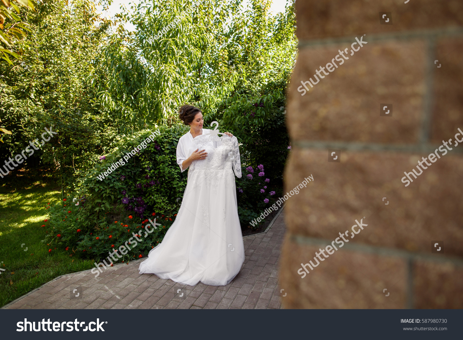 Bride Holding White Wedding Dress In Garden Morning Russian Translation Of The Inscription: Morning Garden Wedding Dresses At Websimilar.org
