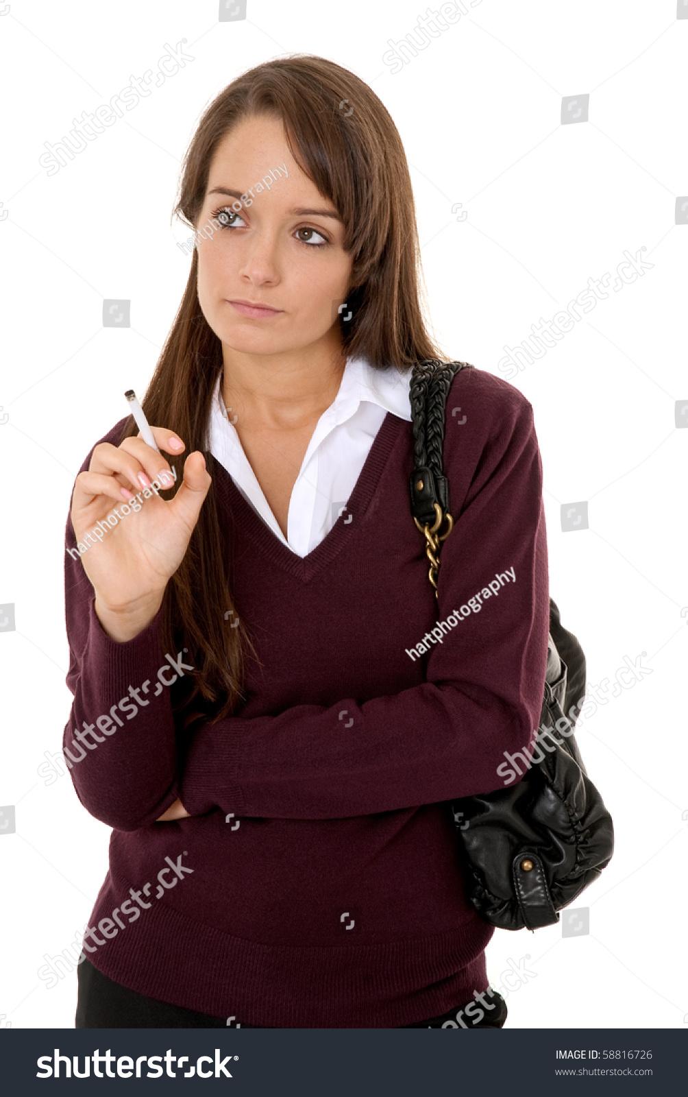 teenage girl smoking cigarette isolated on stock photo