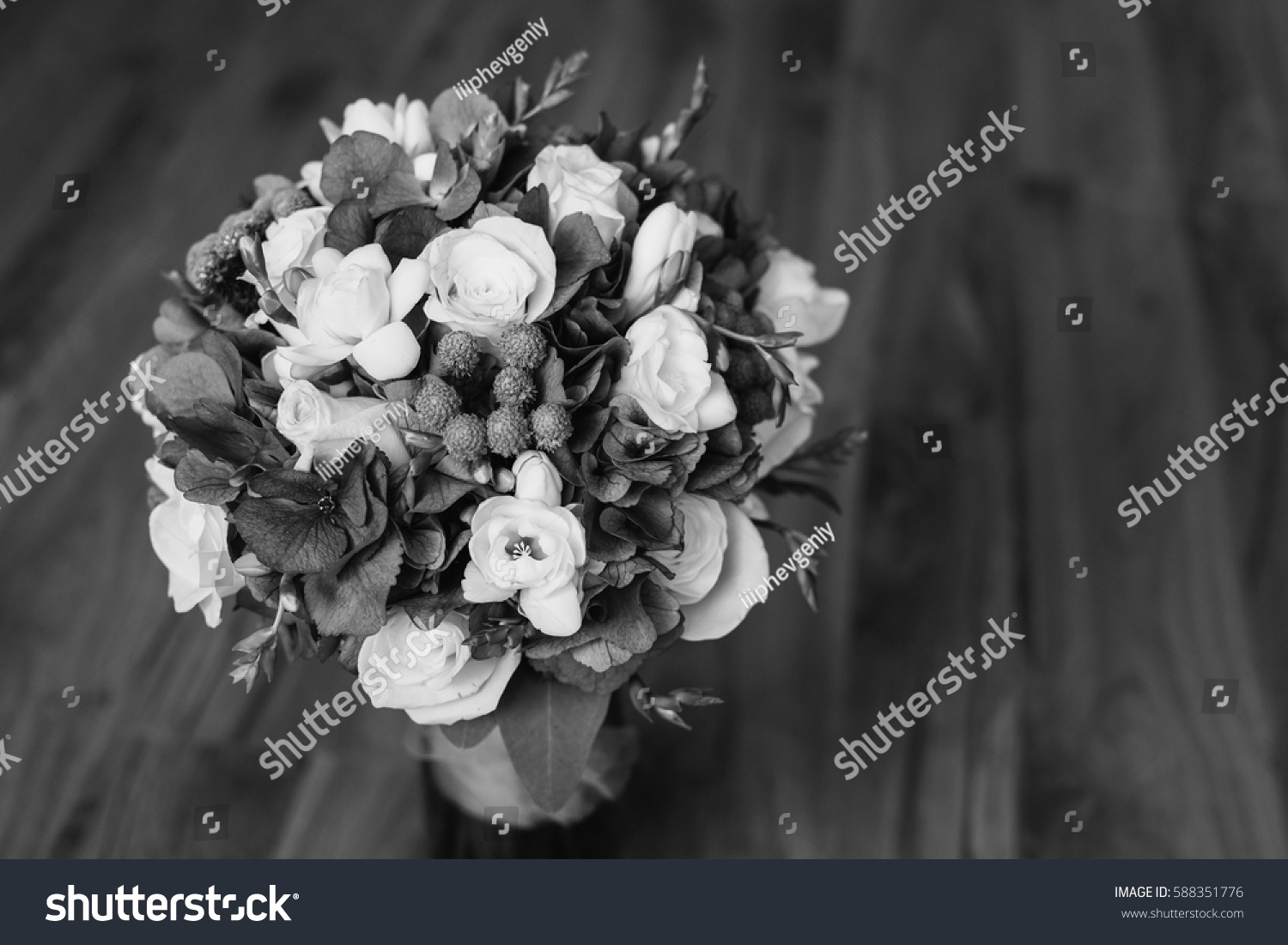 Wedding Bouquet Of White And Blue Flowers In A Transparent Vase