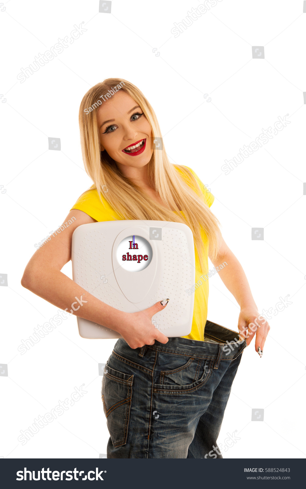 Background image too big - Happy Woman Holding A Scale And Too Big Trousers As She Lost Weight Isolated Over White