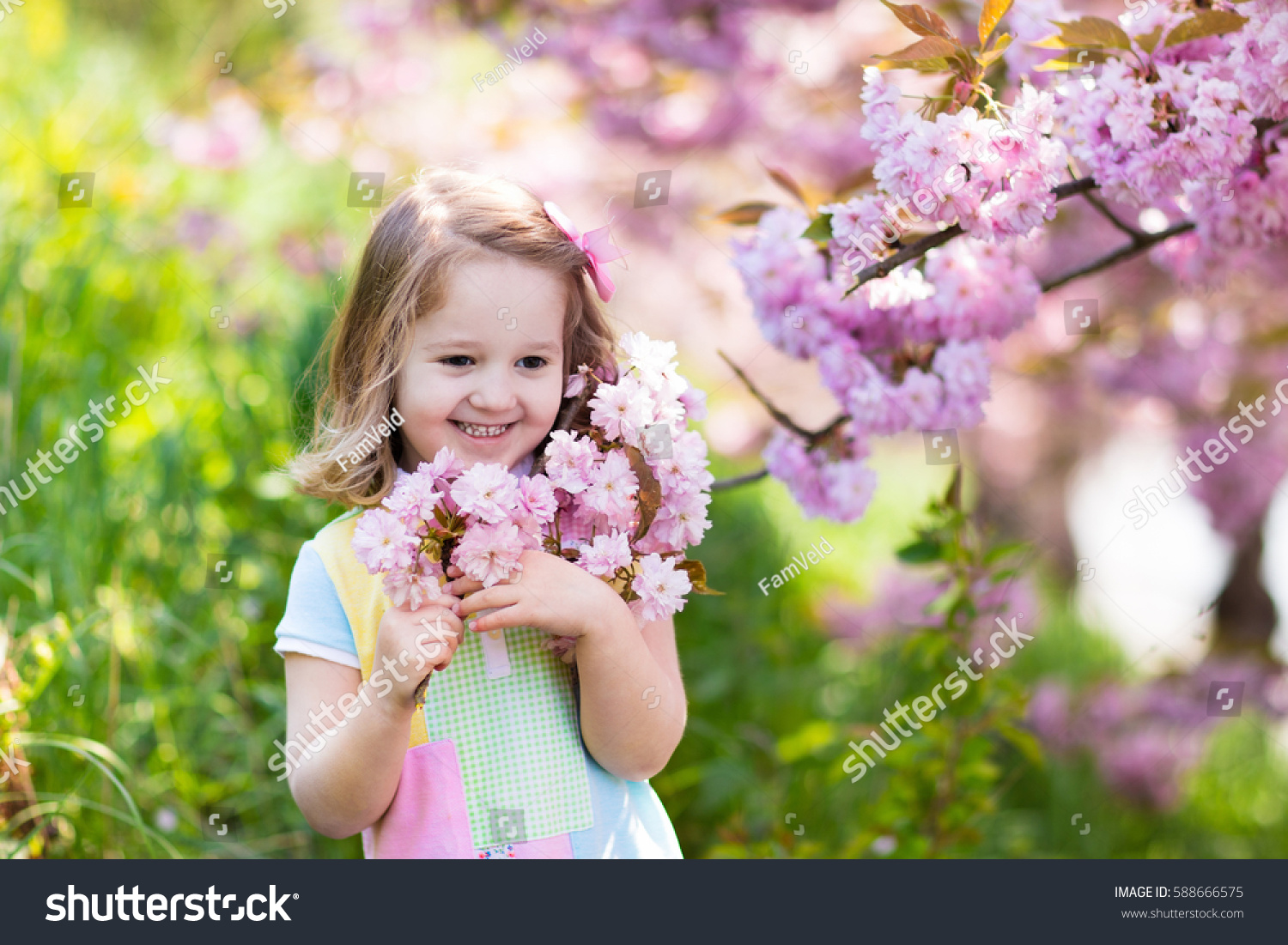 Little Happy Girl Playing Under Blooming Stock Photo Edit Now