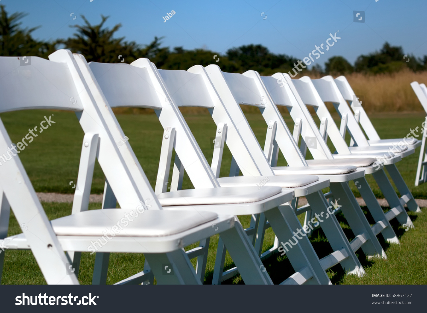 White Chairs At A Wedding Indoor Stock Photo: A Row Of White Chairs At A Wedding Stock Photo 58867127