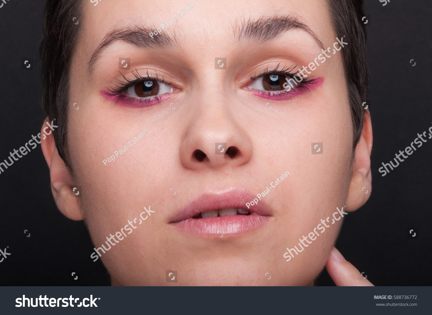 Grimace face clip art stock photo woman pulls a face in upset - Closeup Woman Face In Close Up View With Trendy Make Up On Black Baskground