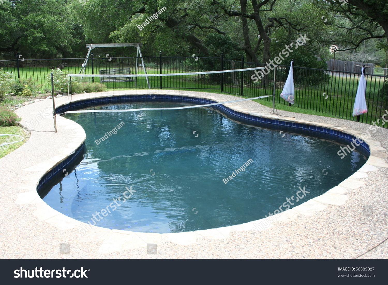 swimming pool volleyball net backyard stock photo 58889087