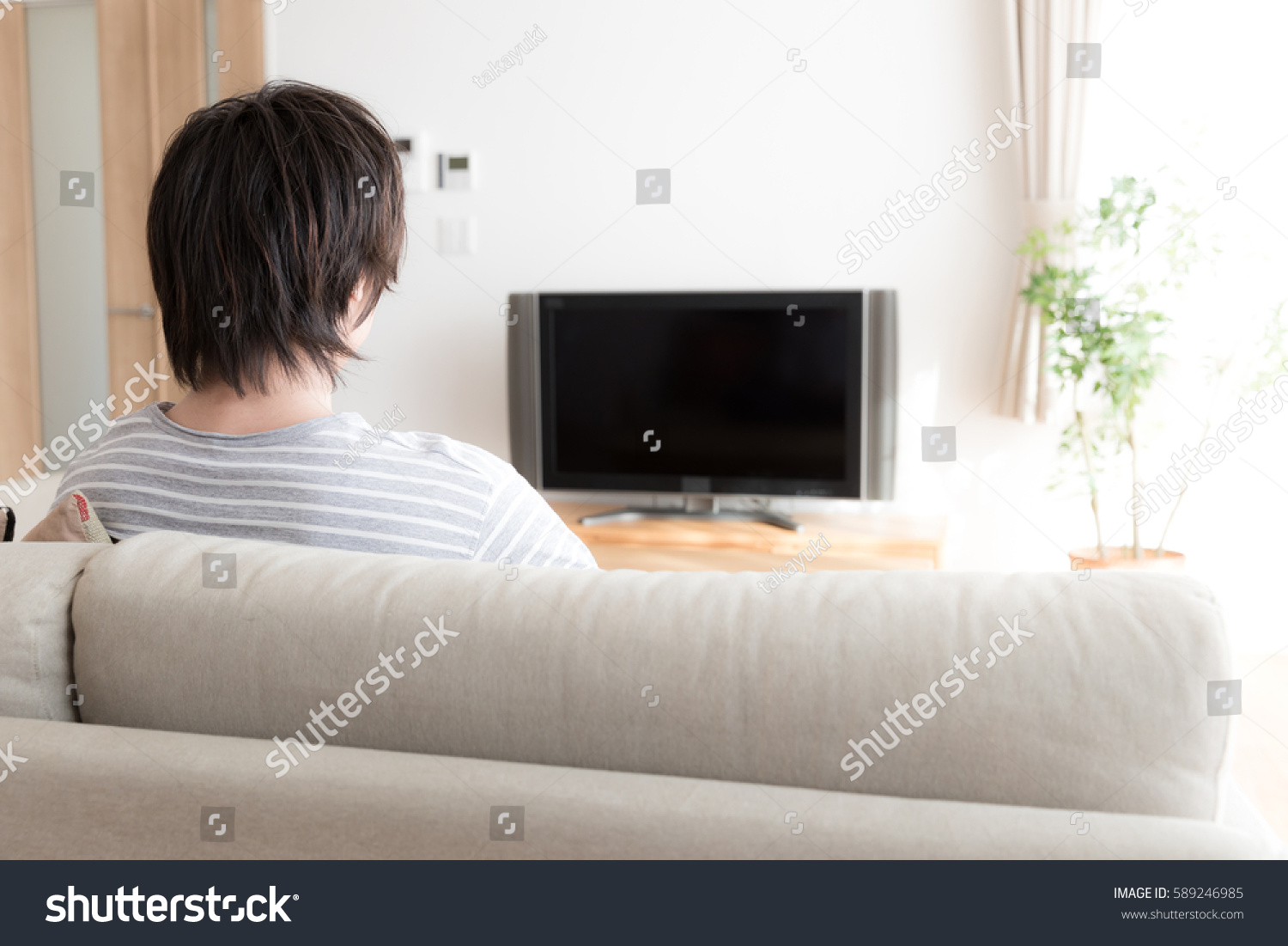 Young Asian Man Watching Tv Living Stock Photo (Download Now ...