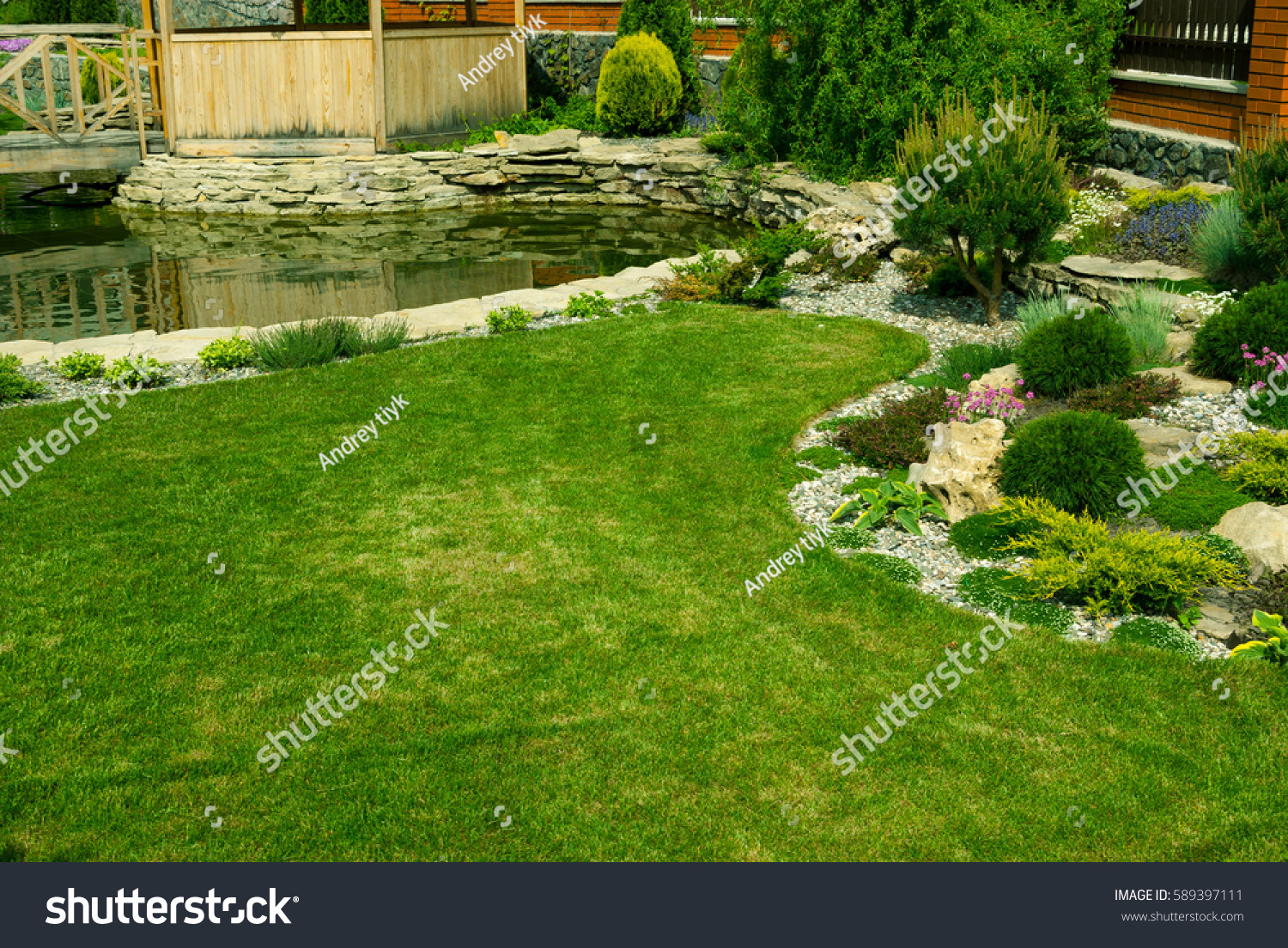 Green lawn colorful landscaped formal gardendetail stock for Formally designed lawn