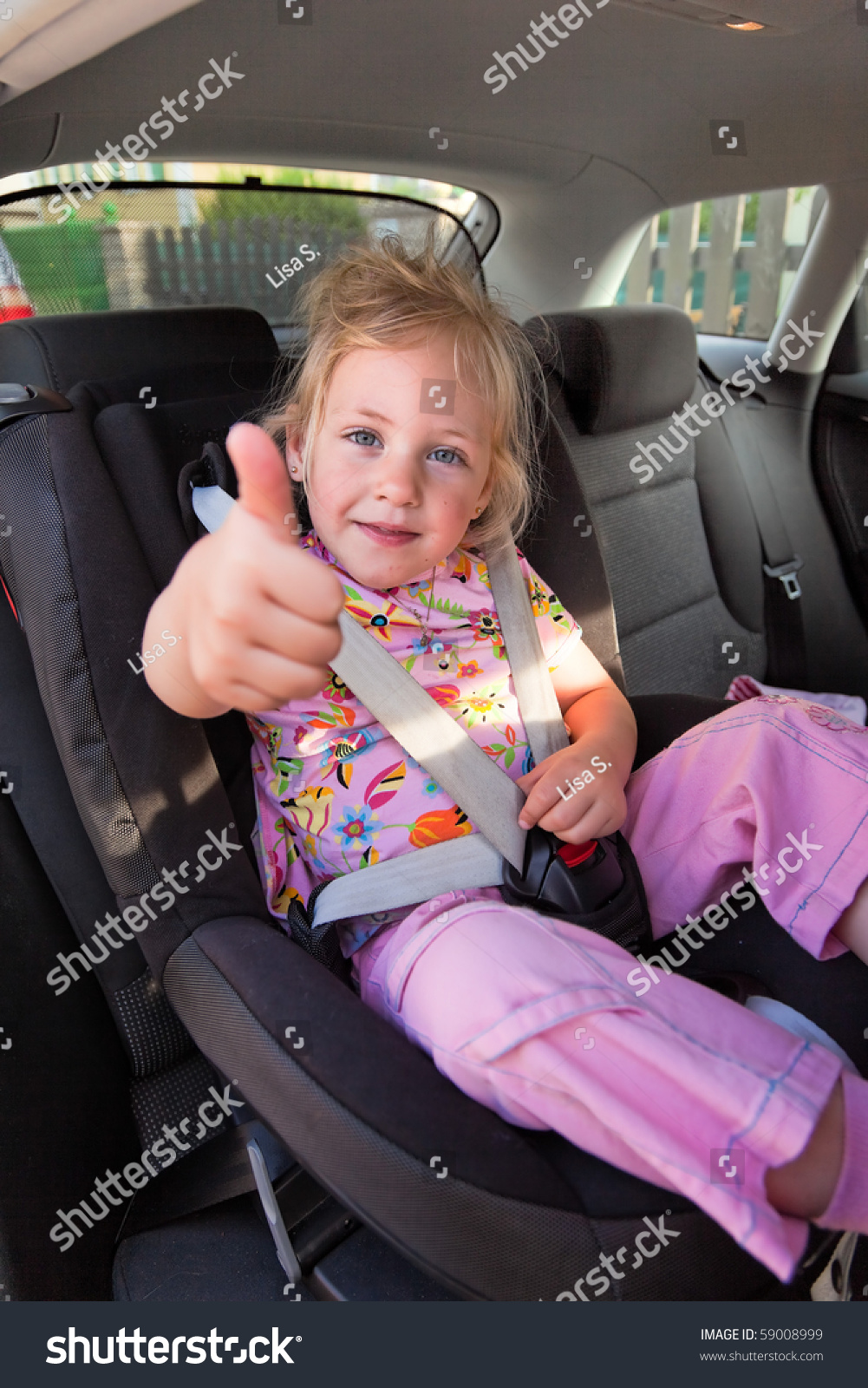 Car Value Website >> Small Child Sitting In A Car Seat In The Car Stock Photo ...