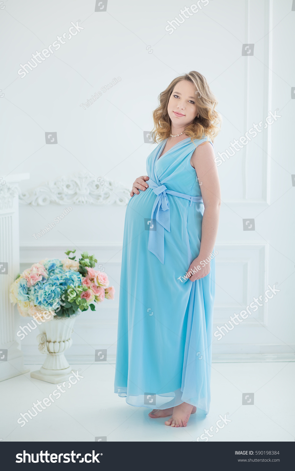 Beautiful Curly Brunette Young Pregnant Woman Stock Photo (Royalty ...