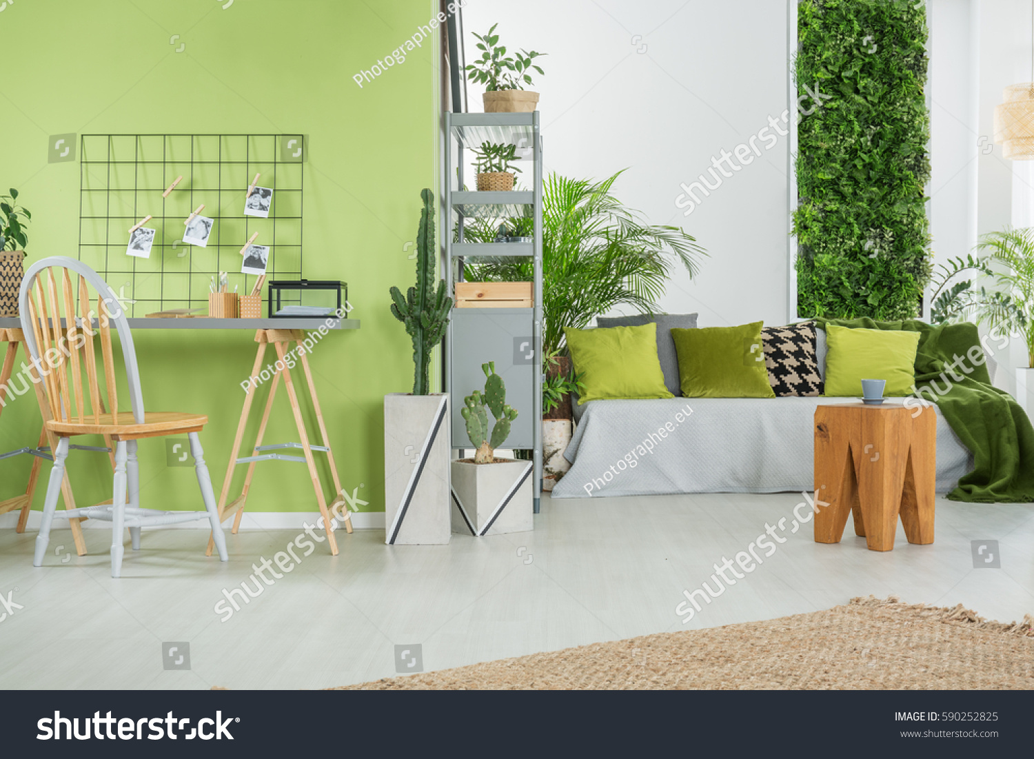 green home interior with sofa desk chair and metal bookcase
