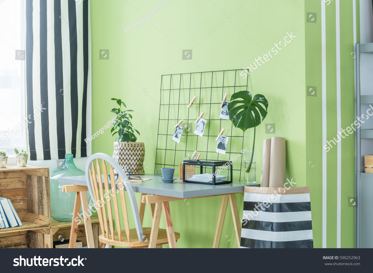 Home Office With Green Plants Desk Chair And Metal Accessories