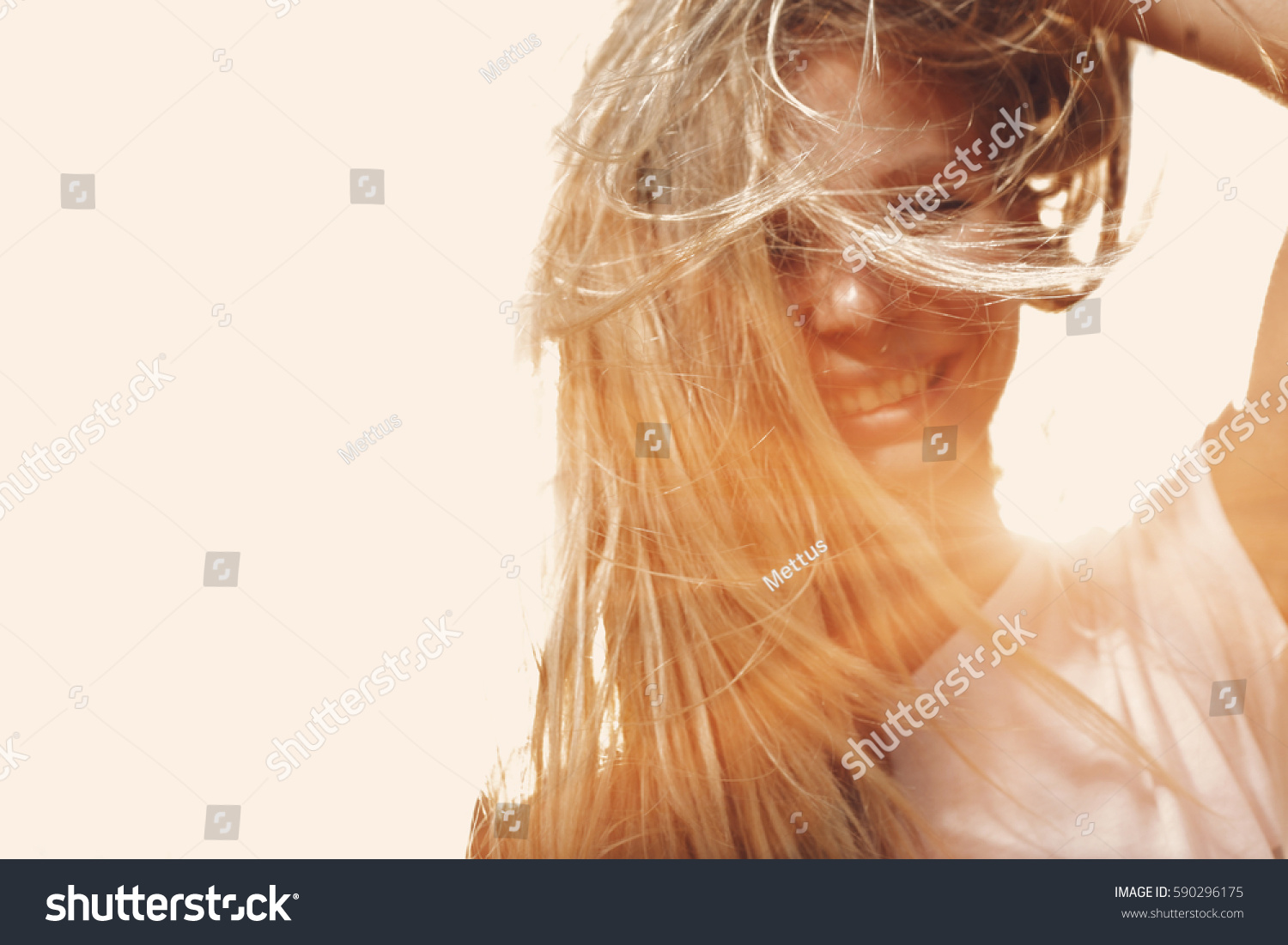 stock-photo-happy-woman-with-windy-messy