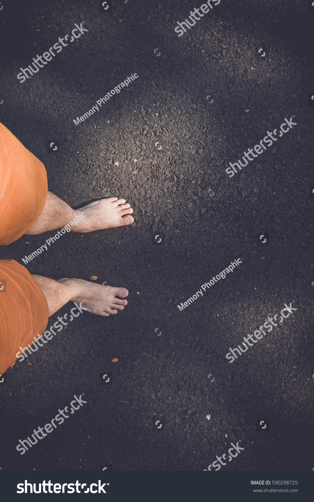 Top view leg bare feet on black road for travel background. #590298725