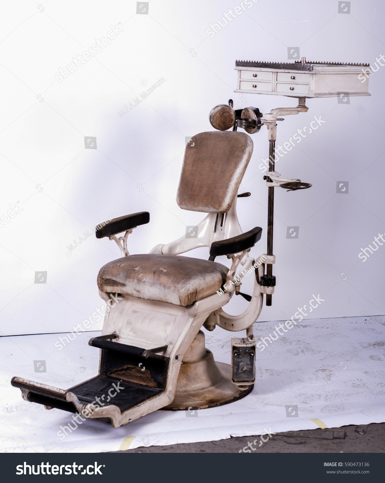 Vintage dental practice. Dental chair and other accessories used by dentists - Vintage Dental Practice Dental Chair Other Stock Photo (Edit Now