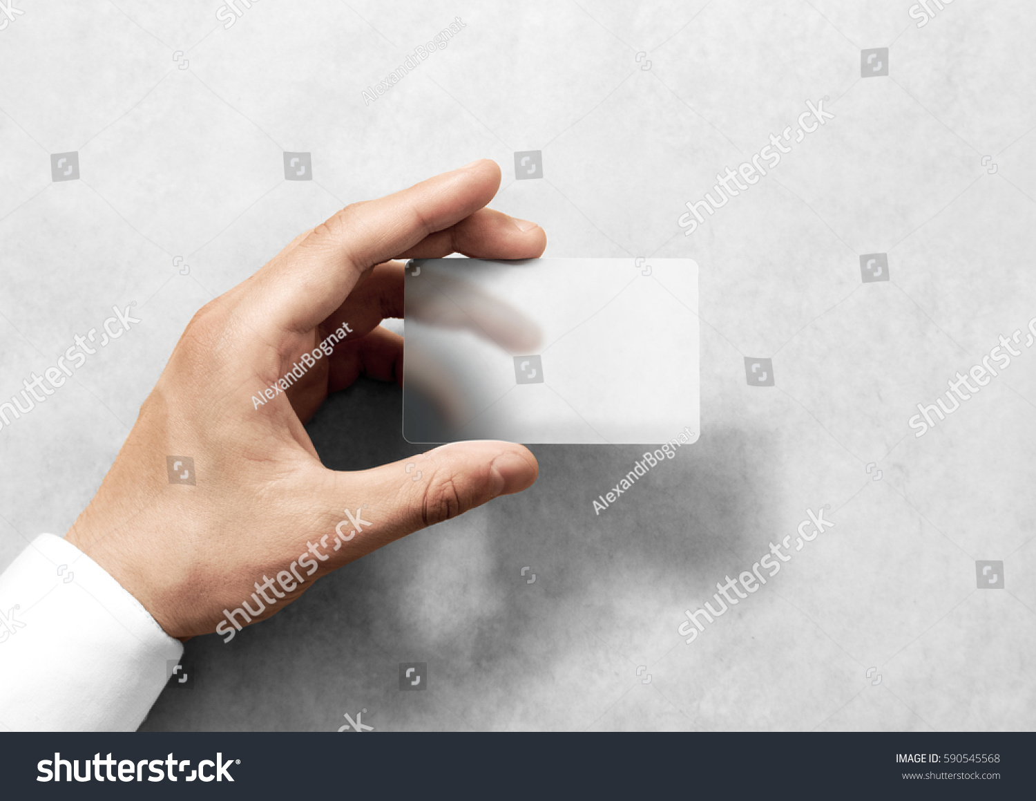 Hand hold blank translucent card mockup with rounded corners. Plain clear call-card mock up template holding arm. Plastic transparent acrylic namecard display front. #590545568