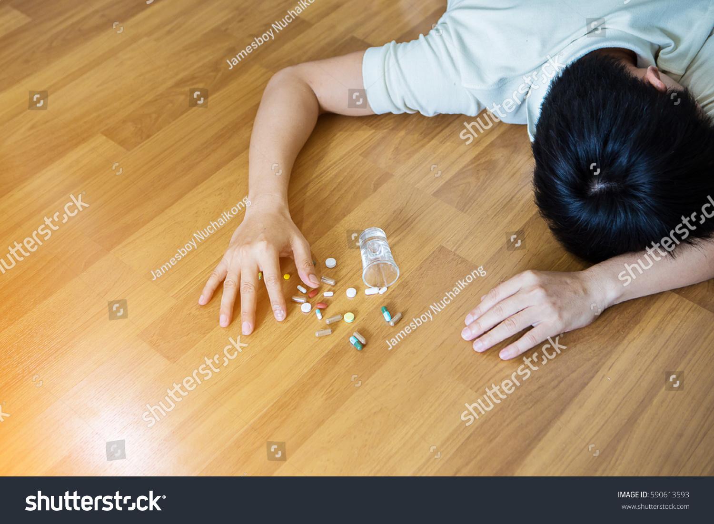 Hand pills on floor selective focus stock photo 590613593 for Hardwood floors hurt feet