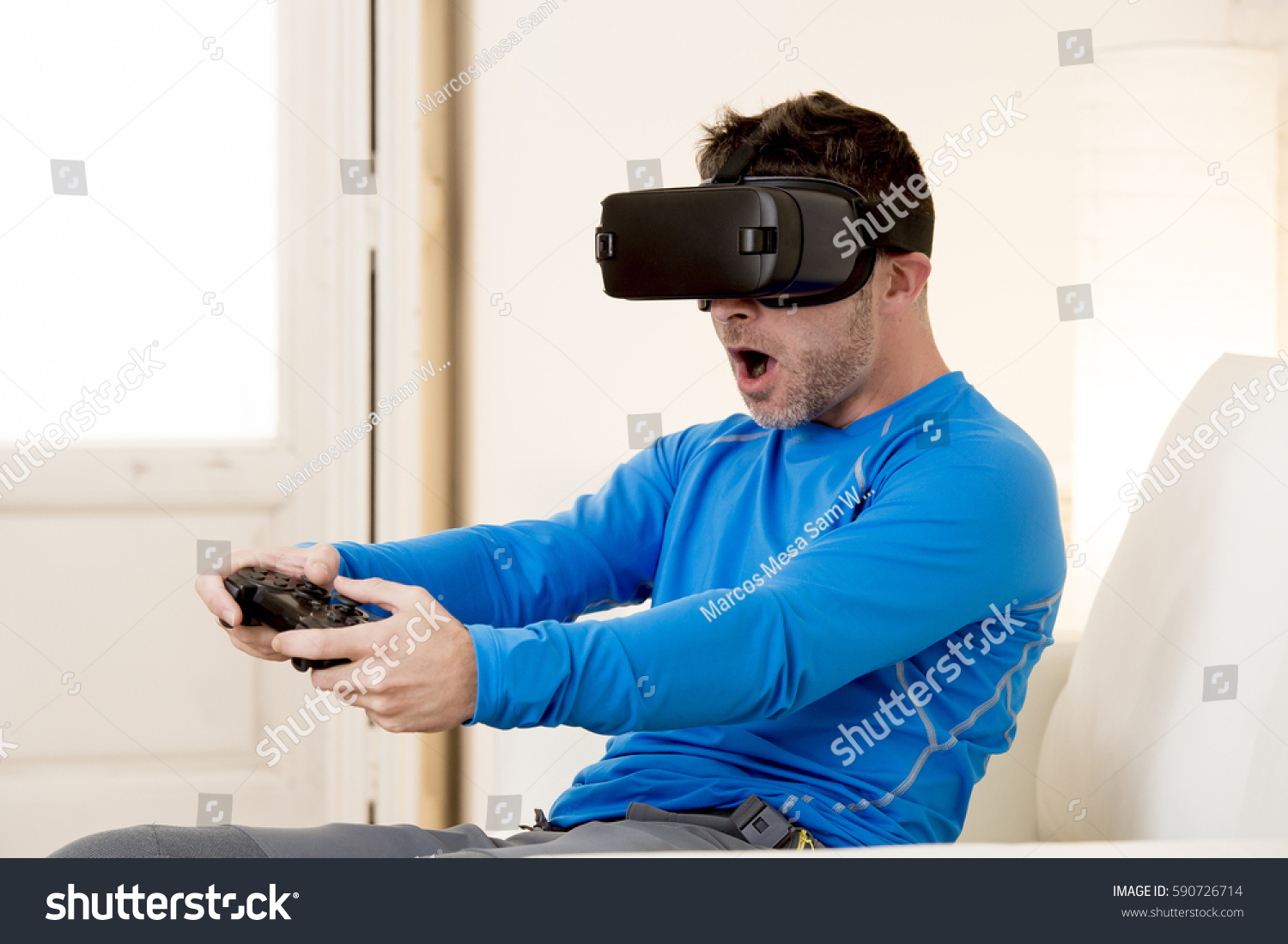 f24bdb709aa young modern man at home living room sofa couch playing video game excited  using 3d goggles watching 360 virtual reality vision enjoying the fun cyber  ...